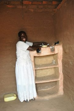 Showing off her cupboard. These are made of mud, with no wood support.